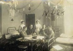 Nurses playing cards with soldiers